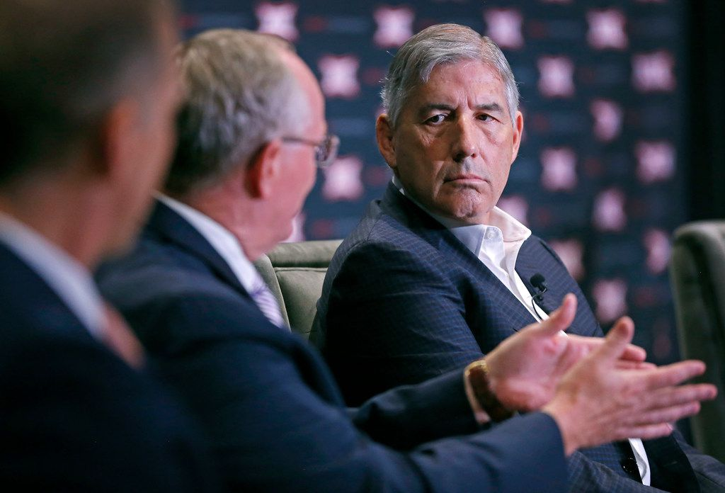 FILE - Big 12 commissioner Bob Bowlsby (right) listens to Kansas State athletic director Gene Taylor (center) during a panel discussion on esports at the Big 12 Conference's state of college athletics forum at Statler Hotel in Dallas on Wednesday, May 23, 2018.