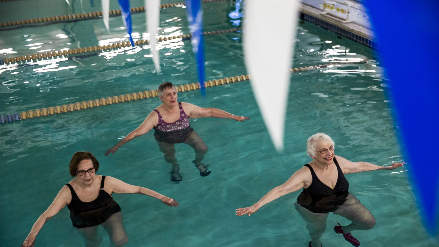 Miriam Cohen (right) does water exercises class with June Lieb (left) and Nancy Weber at Texas Health Finley Ewing Cardiovascular & Fitness Center in Dallas. Cohen has improved from borderline osteoporosis to osteopenia through medication, daily supplements and weekly exercise.