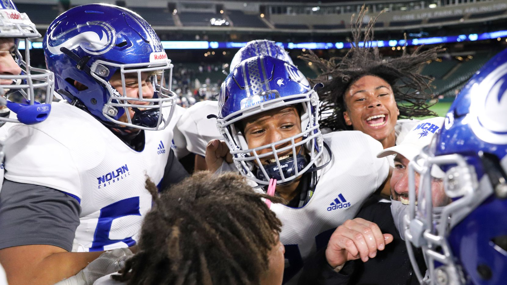Fort Worth Nolan head coach David Beaudin celebrates with his team after a win over Fort Worth All Saints at Globe Life Park in Arlington, Saturday, December 5, 2020.