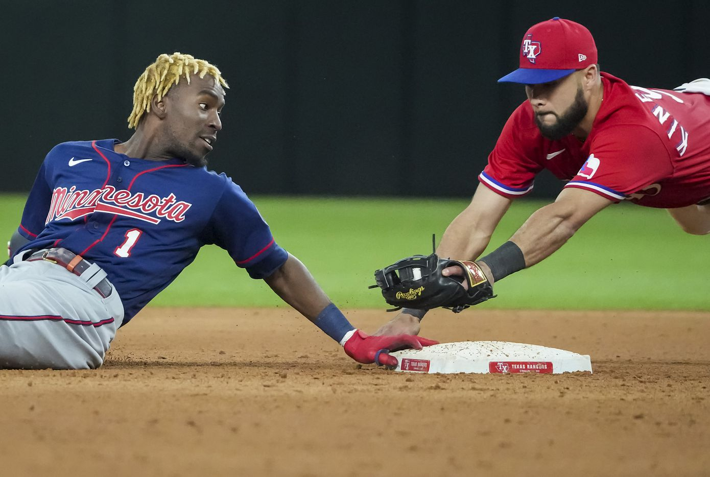 Minnesota Twins center fielder Nick Gordon is safe at second base with a double ahead of the tag from Texas Rangers shortstop Isiah Kiner-Falefa during the ninth inning at Globe Life Field on Friday, June 18, 2021.
