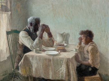 """Henry Ossawa Tanner """"The grateful poor,"""" from 1894, shows a young boy and his grandfather with their heads bowed in prayer over a humble meal.  The exhibition of two paintings by Tanner continues through January 2 at the Dallas Museum of Art.  (Dallas Museum of Art)"""