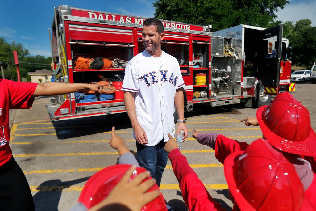 All hands point to former Texas Rangers third baseman Michael Young (center) who came to Frederick Douglass Elementary School in Dallas to help deputize more than 200 students as junior fire marshals, Thursday, April 25, 2019. Young joined Dallas Fire-Rescue and The Hartford (insurance company) in teaching fire safety and prevention. The students met local firefighters, toured the inside of a fire truck, and experienced a simulated fire and smoke demonstration for a hands-on fire safety session. (Tom Fox/The Dallas Morning News)