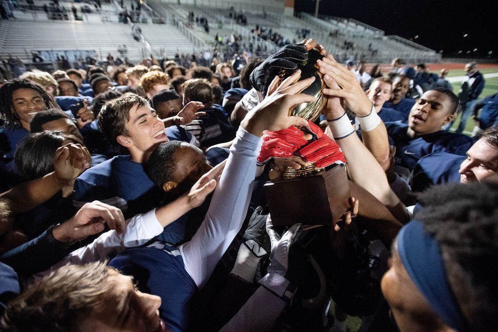 Frisco Lone Star players hoist their trophy after defeating Mansfield Legacy 41-6 in a bi-district round high school football playoff game Friday, November 16, 2018 at Memorial Stadium in Frisco, Texas. Frisco Lone Star won 41-6. (Jeffrey McWhorter/Special Contributor)
