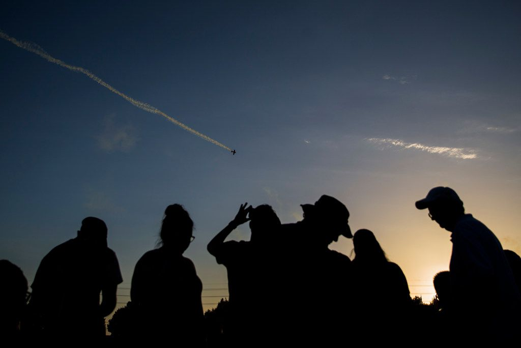 People watch an air show during Kaboom Town festivities in Addison, Texas on Tuesday, July 3, 2018. (Ashley Landis/The Dallas Morning News)