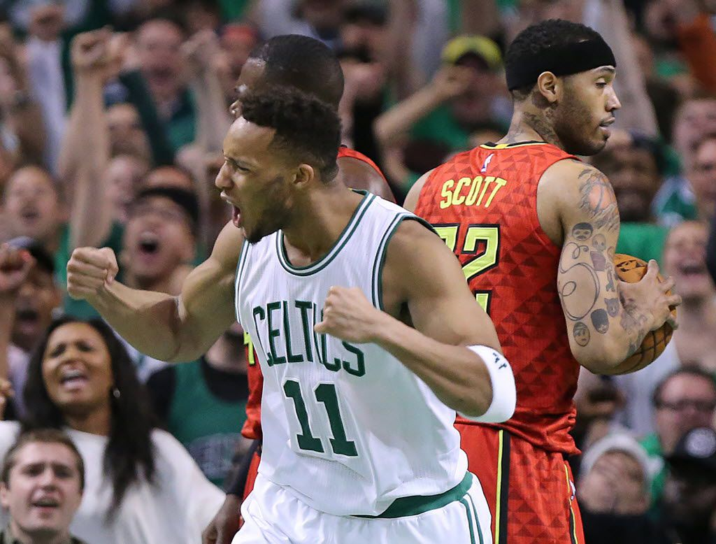Boston Celtics' Evan Turner (11) reacts to scoring against the Atlanta Hawks while Mike Scott prepares to inbound the ball during the third period in Game 4 of a first-round NBA basketball playoff series in Boston on Sunday, April 24, 2016. Boston won, 104-95, in overtime. (Curtis Compton/Atlanta Journal-Constitution via AP) MANDATORY CREDIT