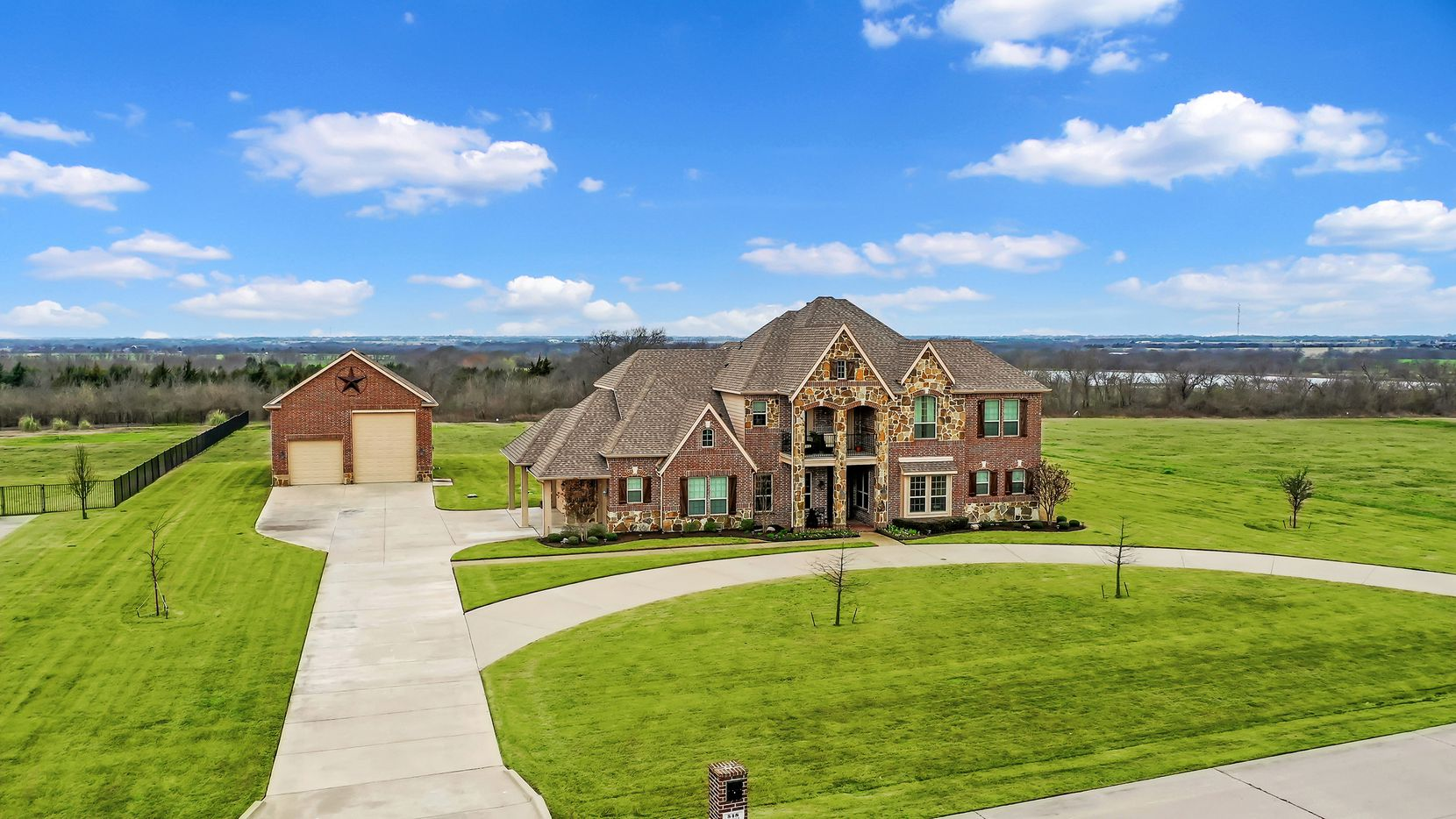 The home at 548 Chisholm Ridge Drive in Rockwall is offered for $724,900. Amenities include a pool with water features and a detached RV garage with a shop.