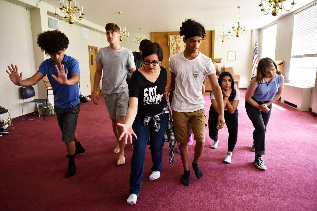 Laurel Mora, 17, (center left) and Matthew Gardara, 17, (center right) lead a group of high school actors from Cry Havoc Theater Company during a rehearsal of Crossing the Line, based on research the troupe conducted on the immigration controversy at the Texas-Mexico border.