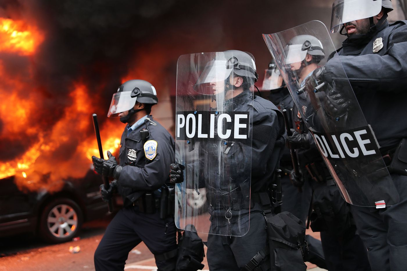 Police and demonstrators clash in downtown Washington after a limo was set on fire following the inauguration of President Donald Trump on January 20, 2017 in Washington, DC. Washington and the entire world have watched the transfer of the United States presidency from Barack Obama to Donald Trump, the 45th president.