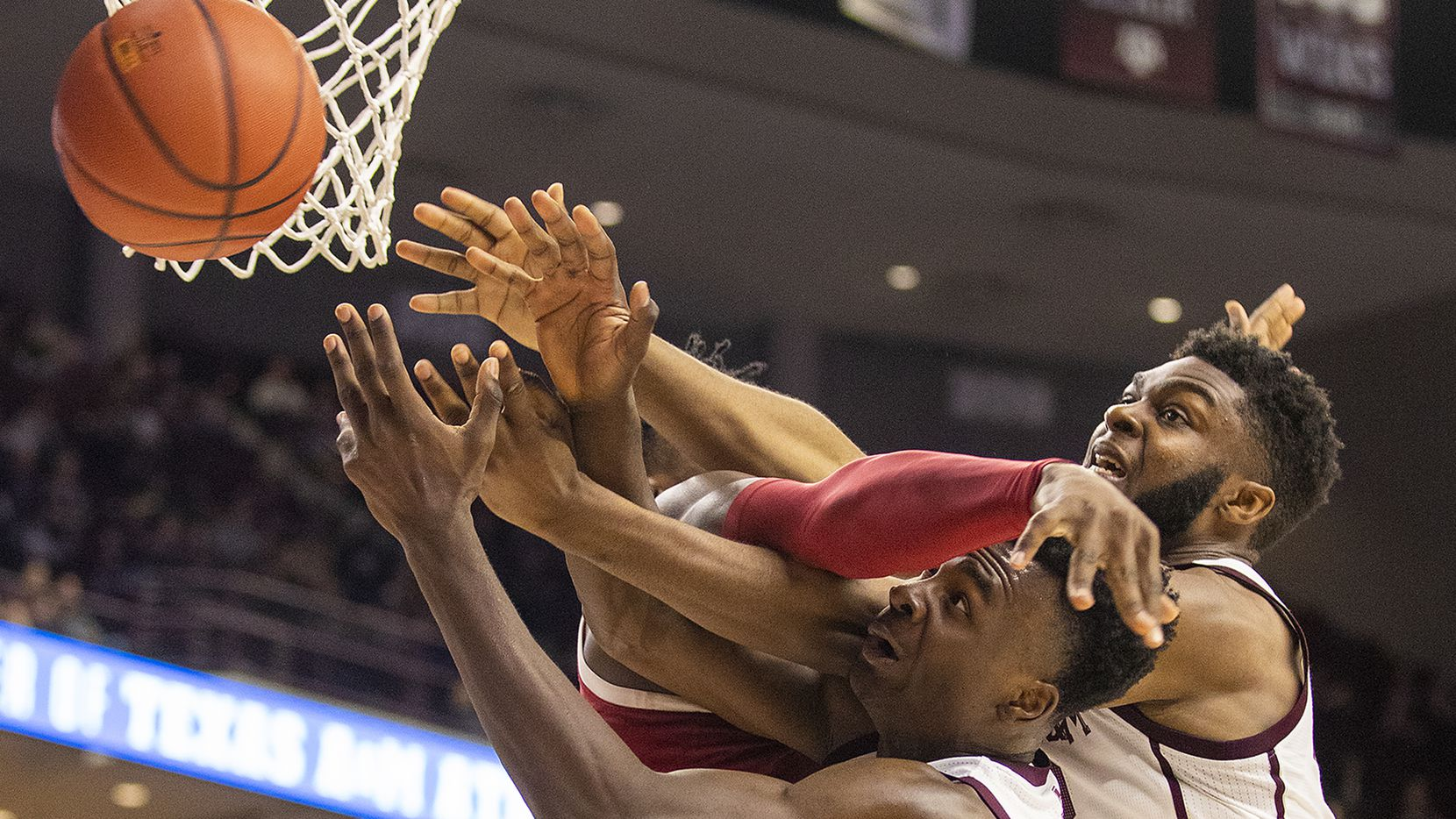 Texas A&M's Emanuel Miller (5) and Josh Nebo (32) vie for a rebound against Arkansas' Adrio Bailey (2) during an NCAA college basketball game game at Reed Arena in College Station, Texas, Saturday, March 7, 2020.