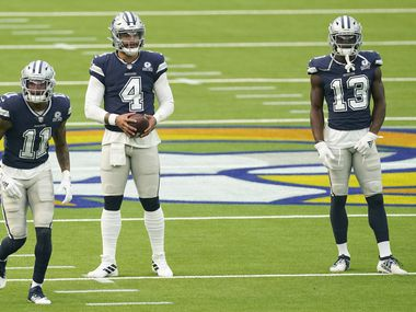 Dallas Cowboys players, from left, Cedrick Wilson (11), Dak Prescott (4) and Michael Gallup (13) warm up before an NFL football game against the Los Angeles Rams Sunday, Sept. 13, 2020, in Inglewood, Calif.