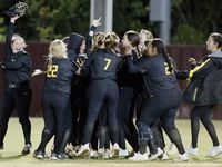 Memorial mobs right fieldr Gabby King (1) after she made a running catch to end the game and Memorial hung on to a one run win as Heritage High School hosted Memorial High School for the District 9-5A softball championship in Frisco on Tuesday, April 20, 2021.