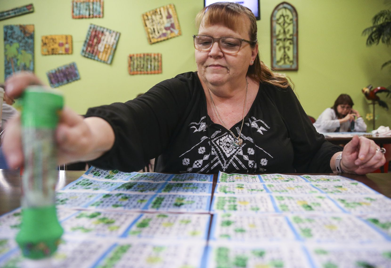 Jeannie Masconi, of Duncanville, Texas, marks her cards during a round of bingo at Jackpot Bingo on Thursday, April 11, 2019 in Duncanville.