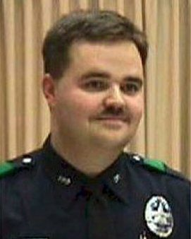 Officer Aubrey Hawkins was killed as he investigated a robbery at an Oshman's Sporting Goods store in Irving.