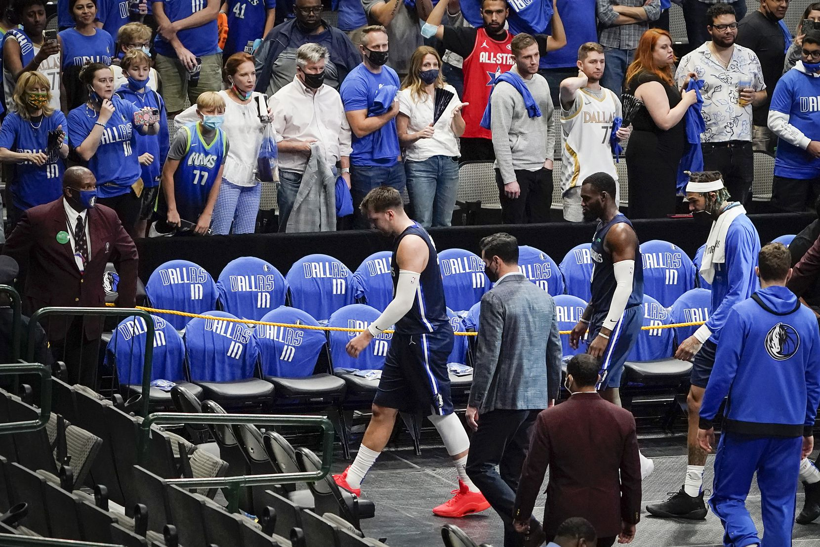 Dallas Mavericks guard Luka Doncic (77), forward Tim Hardaway Jr. (11) and center Willie Cauley-Stein (33) walk off the court following a loss to the LA Clippers in an NBA playoff basketball game at American Airlines Center on Friday, May 28, 2021, in Dallas. (Smiley N. Pool/The Dallas Morning News)