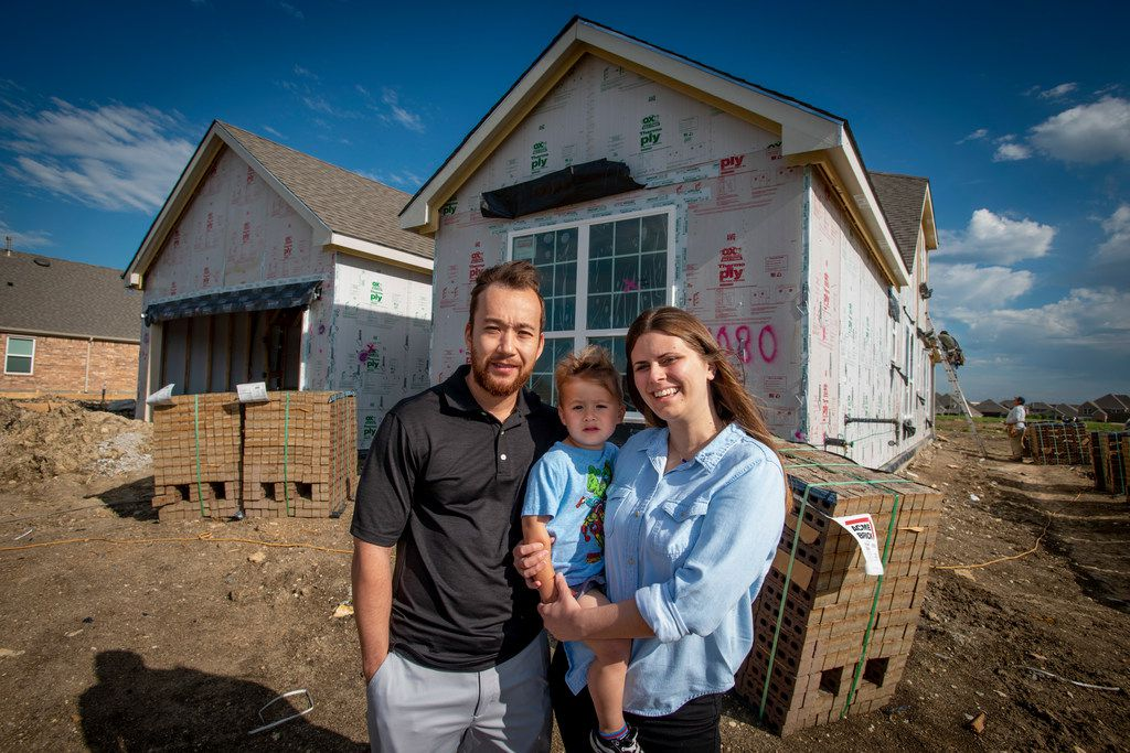 The Brace family, James, Lucas and Samantha, outside their new home in Fort Worth on April 27, 2019.  Samantha Brace is a Fidelity employee who has used a company benefit to help her pay down college debt. She says she and her husband have been able to put their money toward building a new house and raising their son.
