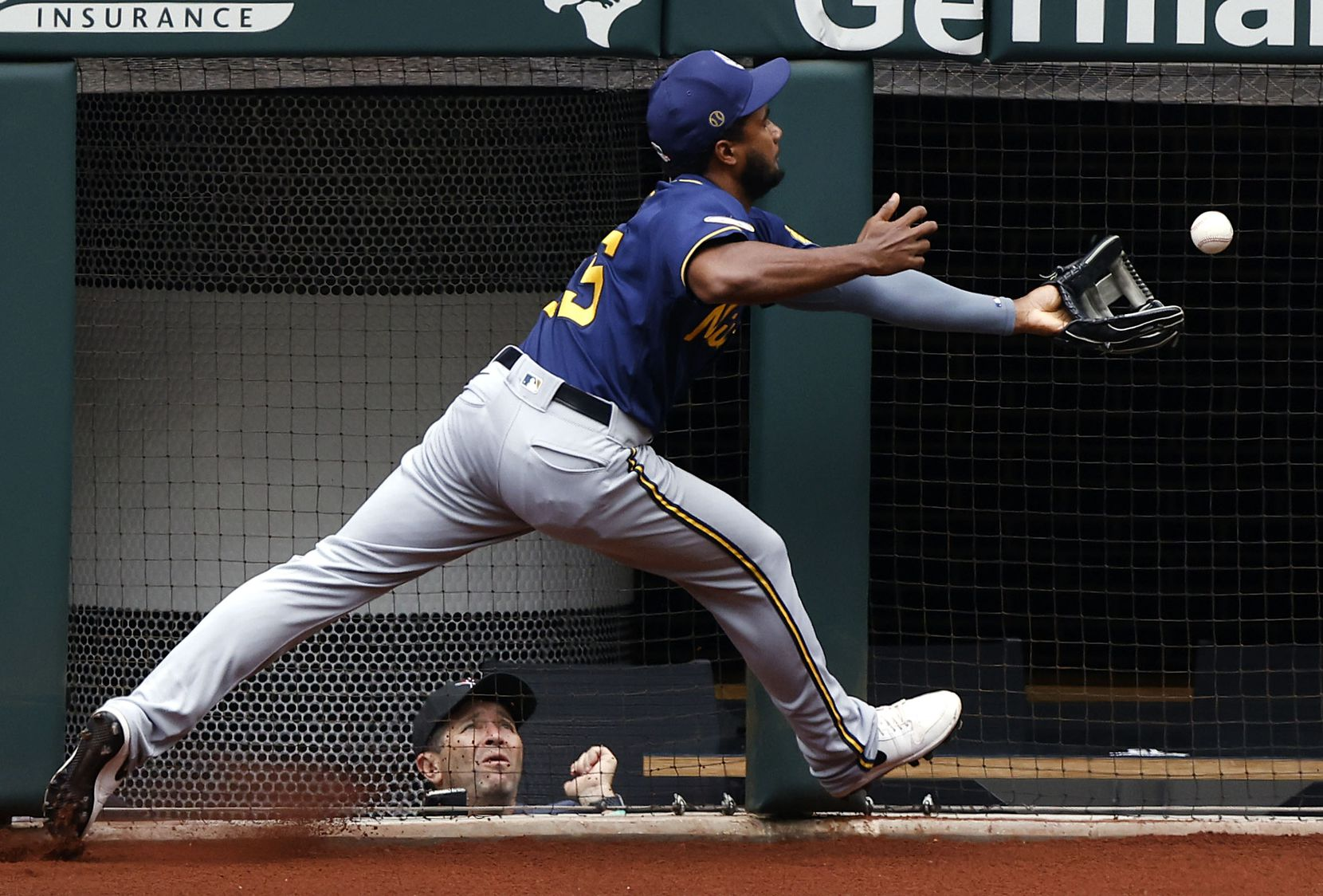 Milwaukee Brewers third baseman Pablo Reyes bobbles a Texas Rangers fly ball in the sixth inning at Globe Life Field in Arlington, Texas. The teams were playing in an exhibition game, Tuesday, March 30, 2021. (Tom Fox/The Dallas Morning News)