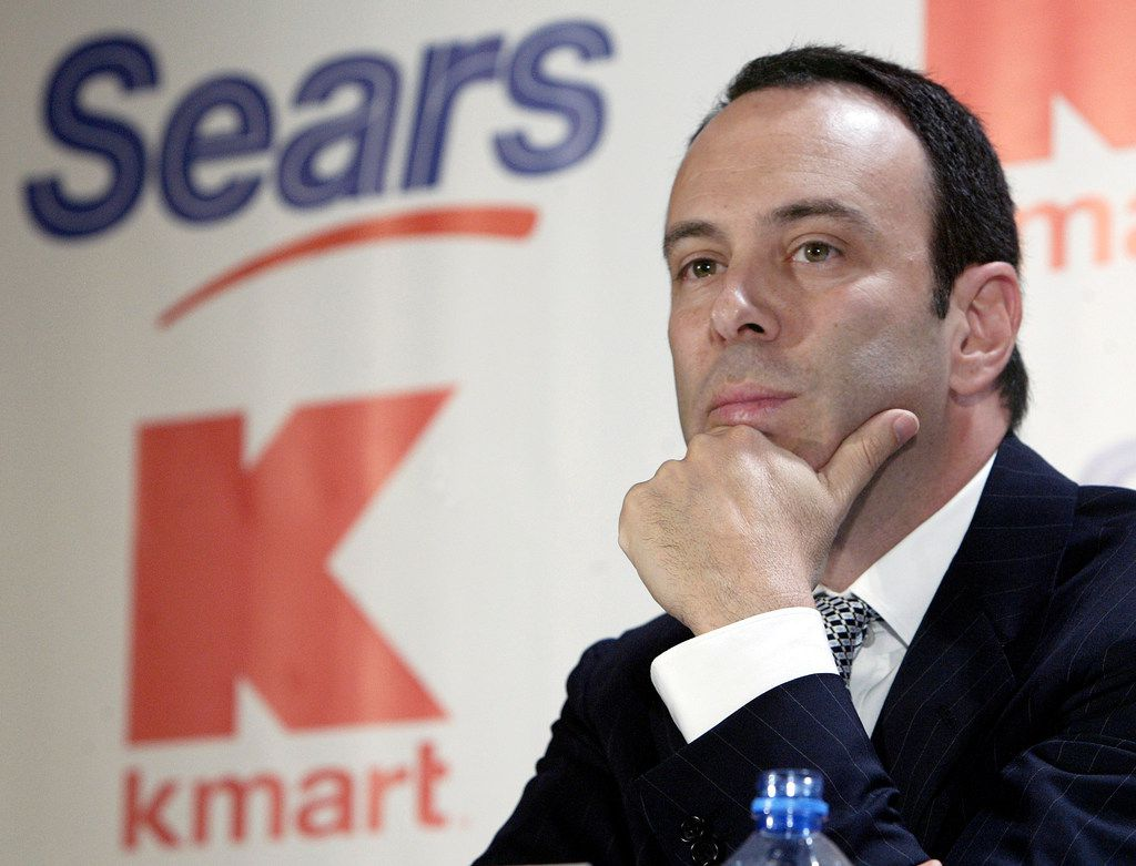 FILE- In this Nov. 17, 2004, file photo Kmart chairman Edward Lampert listens during a news conference to announce the merger of Kmart and Sears in New York. As Sears teeters on the brink of collapse, there's one man at the center of the fight for the future of the iconic retailer. Lampert plays several, often conflicting, roles in what could be the final chapter for the company that began as a mail order watch business 132 years ago. He's been chairman, CEO, landlord, lender, and largest shareholder all at the same time. If the company survives, he wins. If it ends up liquidating, he also wins. (AP Photo/Gregory Bull, File)