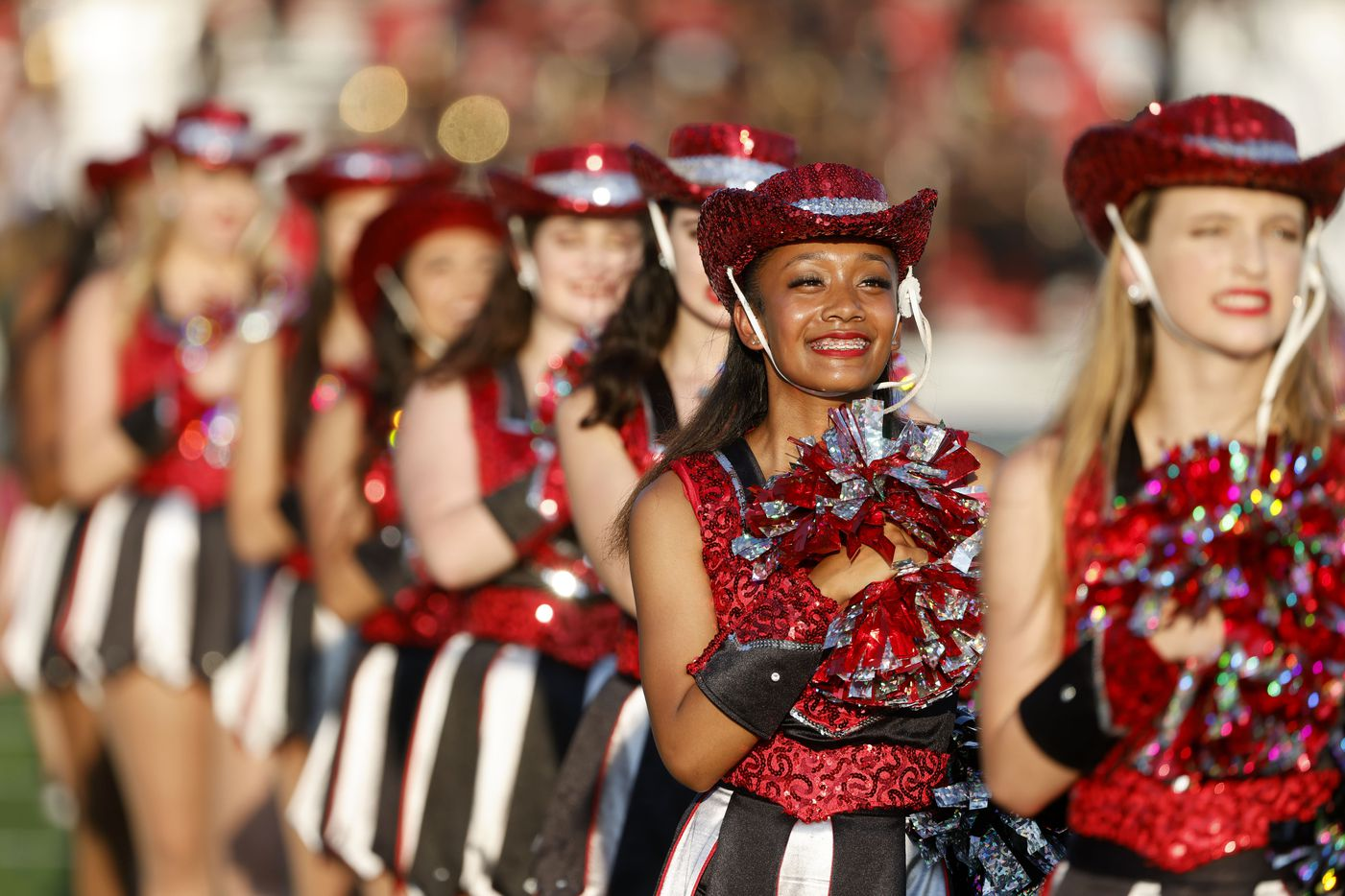 The Troy-Ann drill team of Euless Trinity performs prior to their their high school football game against Arlington Lamar, in Bedford, Texas on Aug. 26, 2021. (Michael Ainsworth/Special Contributor)