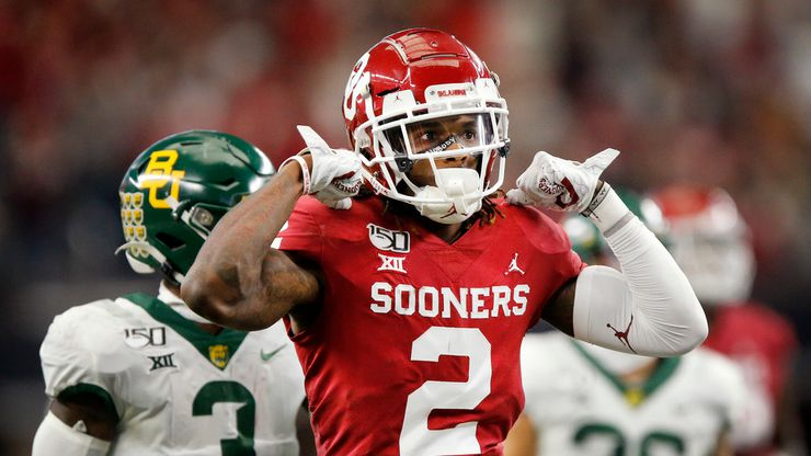 FILE — Oklahoma Sooners wide receiver CeeDee Lamb (2) flexes his muscles after he took a hit on a first quarter pass reception against the Baylor Bears in the Big 12 Championship at AT&T Stadium in Arlington, Saturday, December 7, 2019.