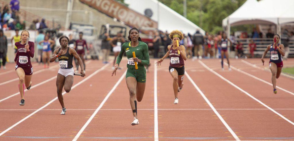 Desoto's Rosaline Effiong (1561) leads the pack as she heads toward the finish during the Division II high school girls 4x100 meter relay at the Texas Relays track meet at the Mike A. Myers Stadium, at the University of Texas on March 30, 2019 in Austin, Texas.