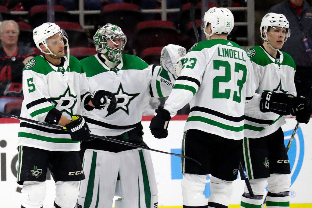 Dallas Stars' goaltender Anton Khudobin is congratulated by his teammates after a victory over the Carolina Hurricanes in Raleigh, N.C., on Tuesday, Feb. 25, 2020. (AP Photo/Chris Seward)