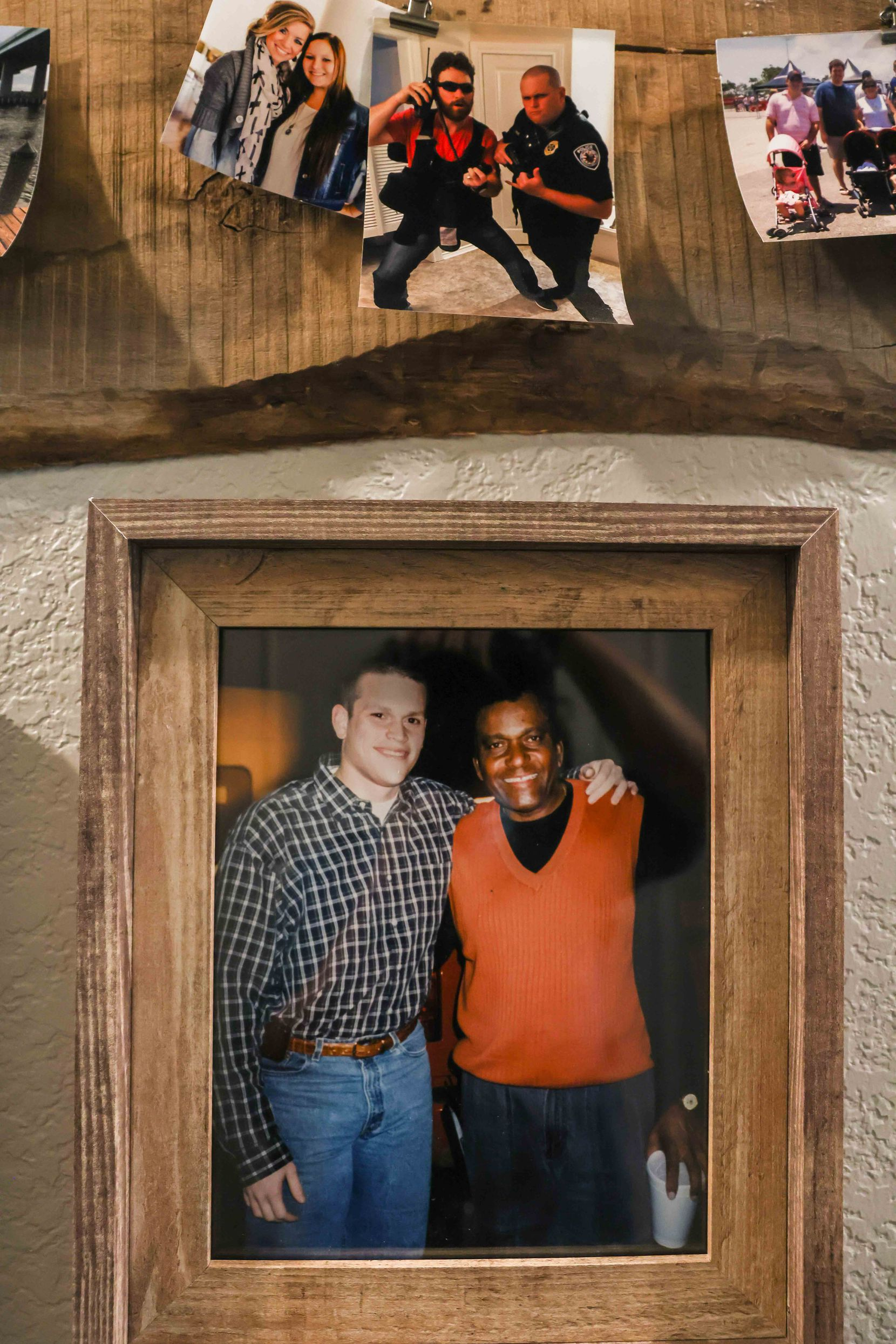 A photo of Tyler Tines Pride and Charley Pride hangs on a wall at his home in Lindale, Texas.