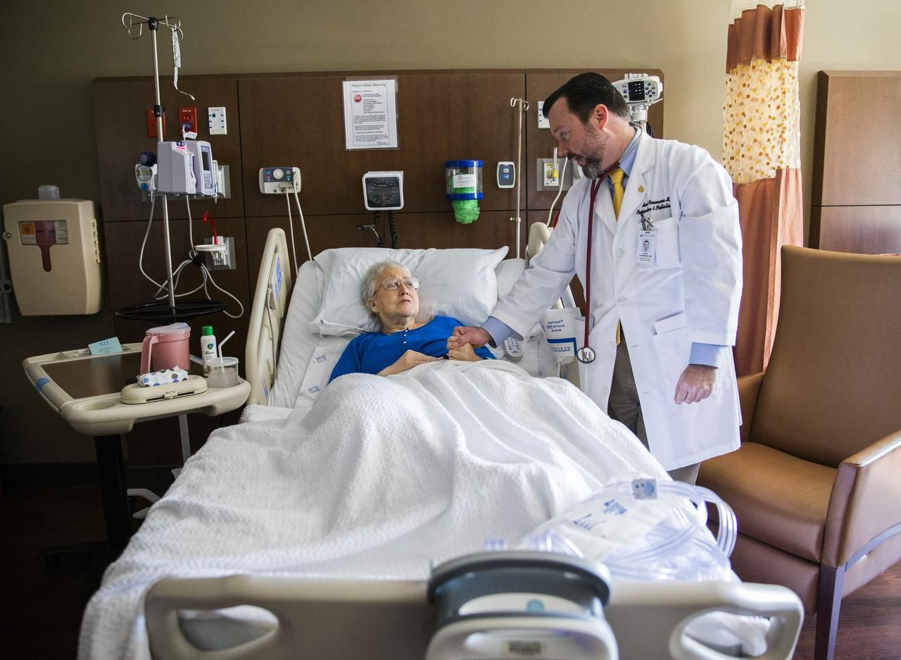 Dr. Mark Casanova checks on a patient at Baylor University Medical Center in Dallas. Casanova is one of the doctors explaining how vaccination status could soon become an accepted part of triage for hospital admittance.