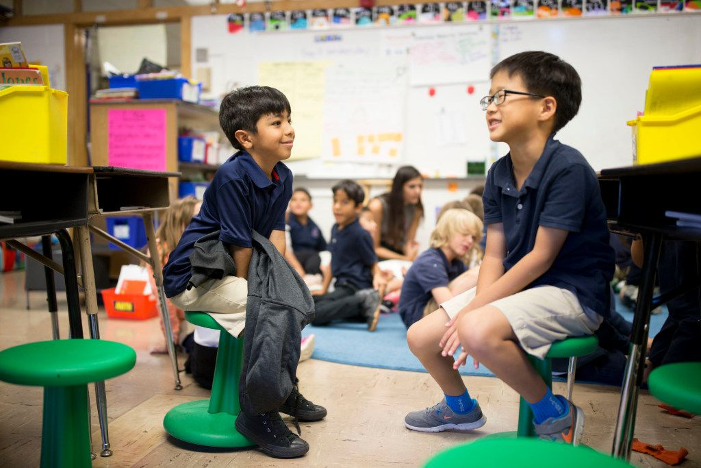 Jordan Saucedo (left), 7, and Daniel Kang, 7 sit on wobble stools donated though DonorsChoose.org during second-grade reading class at Hexter Elementary. (Ting Shen/Staff Photographer)