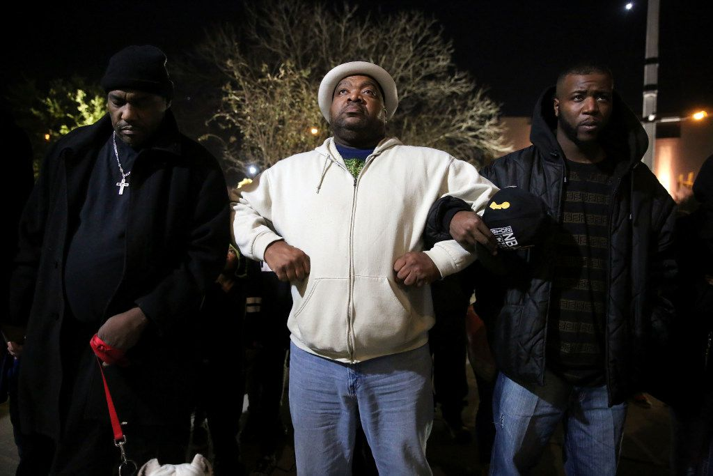 From left: Protesters Ernest Walker, Cecil Callier and Mdot White joined in prayer outside the Tarrant County Courthouse in  Fort Worth last December. They were part of a demonstration staged after a viral video showed a Fort Worth police officer's confrontation with a black woman and her family.