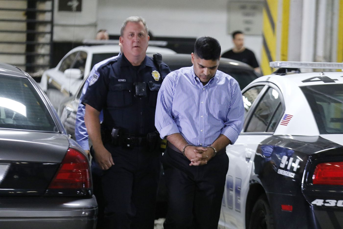 Wesley Mathews, right, adoptive father of Sherin Mathews, was arrested and charged with Injury to a Child arrives at the Lew Sterrett Justice Center on Wednesday, October 25, 2017 in Dallas. He was transferred from the Richardson, Texas jail and his bond has been set at $1,000,000. He was arrested on Oct. 23, 2017 after offering a new account of how his daughter went missing two weeks earlier. (David Woo/The Dallas Morning News)