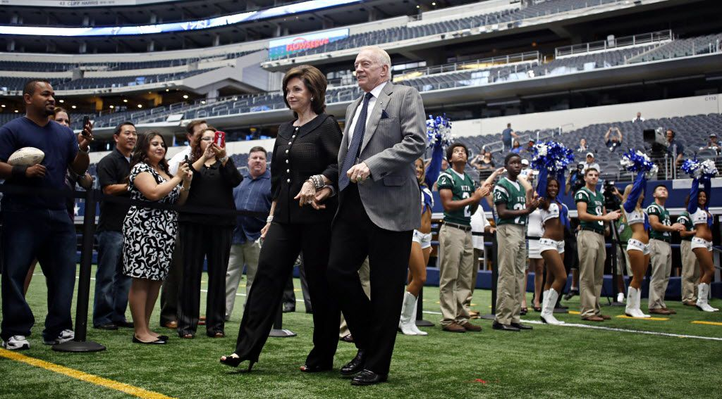 Dallas Cowboys owner Jerry Jones (right) and his wife, Gene Jones, are introduced during the Cowboys Kickoff Luncheon Wednesday, August 28, 2013 at Cowboys Stadium in Arlington.