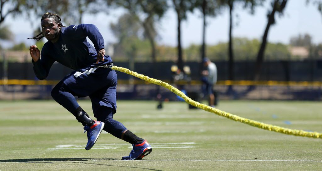 Dallas Cowboys rookie outside linebacker Jaylon Smith works on a resistance cord as he rehabs his knee injury from last season during a morning walk thru at training camp in Oxnard, California, Monday, August 15, 2016. (Tom Fox/The Dallas Morning News)