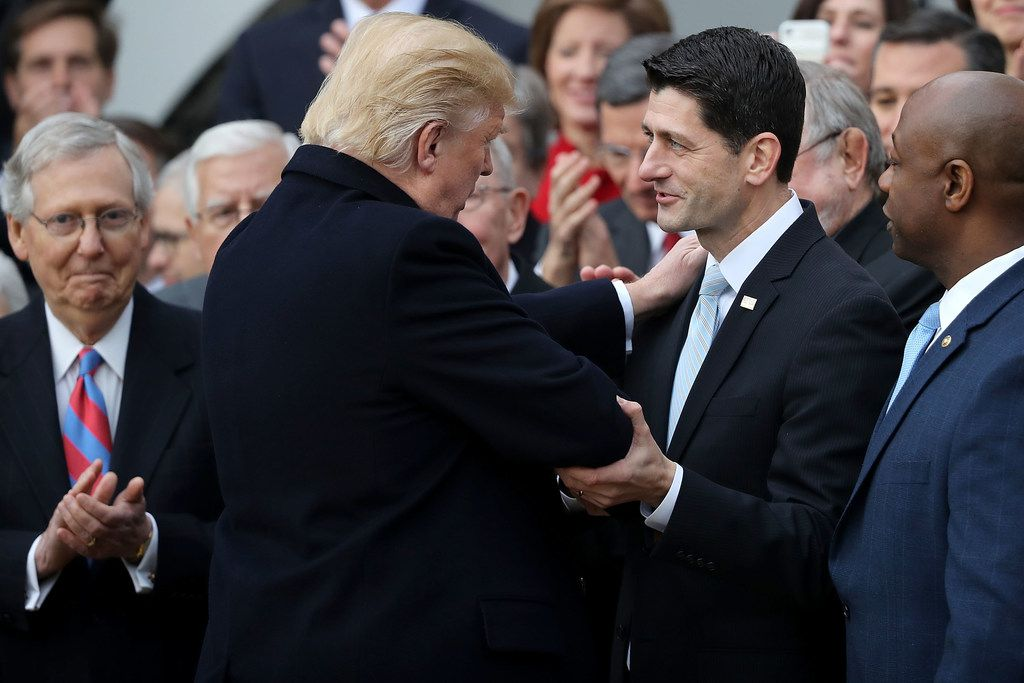 U.S. President Donald Trump congratulates Speaker of the House Paul Ryan, R-Wisconsin, after Congress passed the Tax Cuts and Jobs Act.