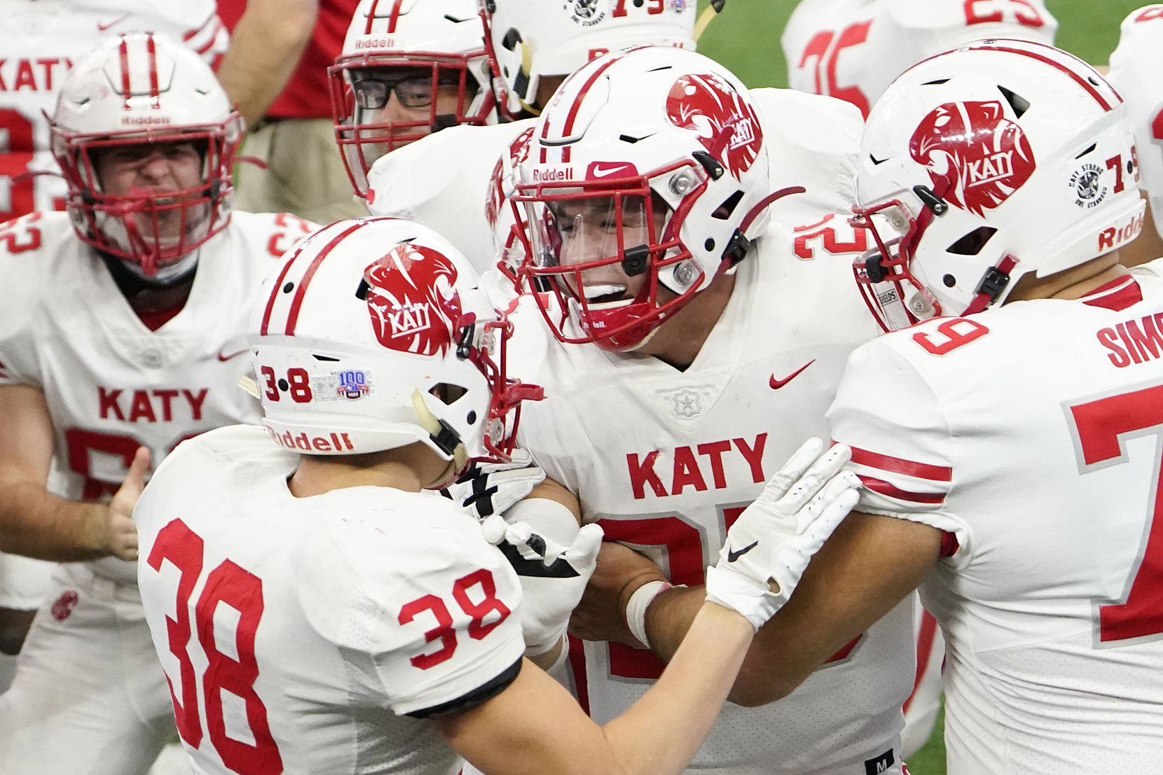 Katy linebacker Shepherd Bowling (25) celebrates with teammates after interceptin a pass intended for Cedar Hill wide receiver Anthony Thomas IV during the first half of the Class 6A Division II state football championship game at AT&T Stadium on Saturday, Jan. 16, 2021, in Arlington, Texas.