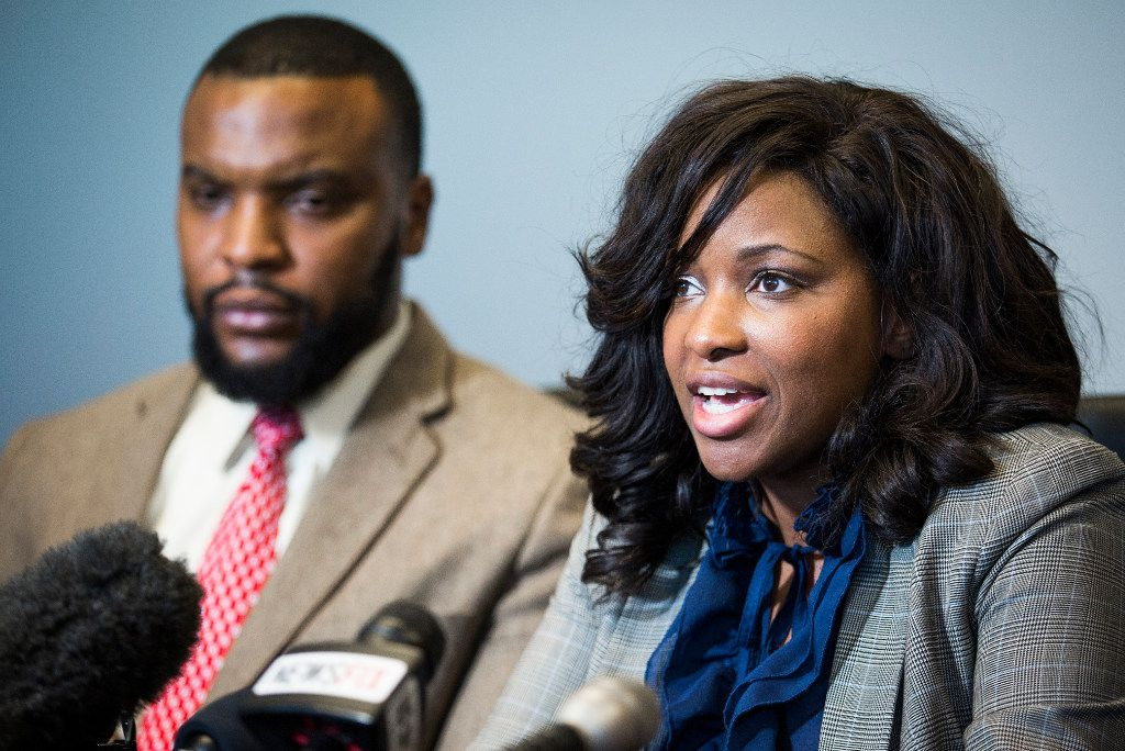 Attorneys Jasmine Crockett (front) and Lee Merritt, who represent Jacqueline Craig, hold a press conference  Thursday in downtown Dallas.