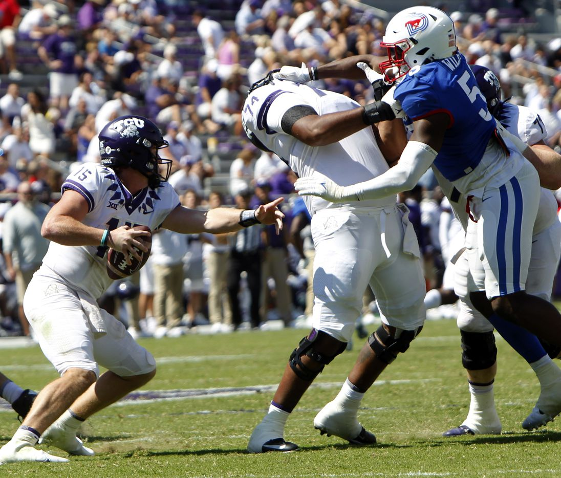 TCU quarterback Max Duggan (15), left, maneuvers around the block of offensive lineman Andrew Cokker (74) as he is challenged by SMU defensive lineman Gary Wiley (55) during 4th quarter action. Although Cokker questioned a game official, there was no penalty called on the play. SMU won 42-34. The two teams played their NCAA football game at Amon G. Carter Stadium on the campus of TCU in Fort Worth on September 25, 2021. (Steve Hamm/ Special Contributor)