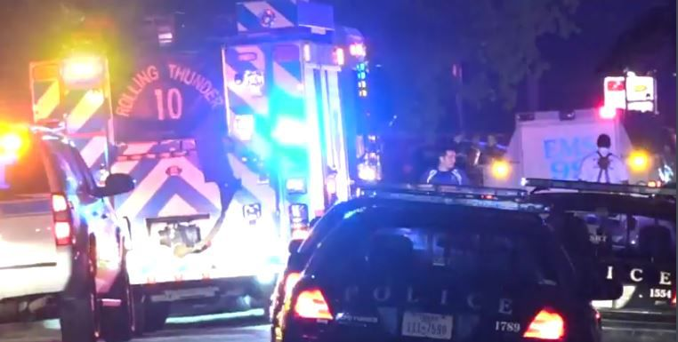 Police and paramedics respond to the shooting on Davis Street in South Fort Worth.