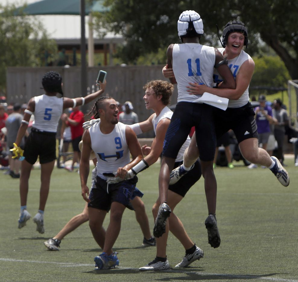Hebron players Jack Autry (17), upper right, and Cobye Baldwin (11) jump for joy as they celebrate with Hawks teammates after their 28-26 victory over Lake Travis in the championship game to claim the Division 1 title. The state 7 on 7 football tournament attracted athletes from schools throughout the state. The competition brackets for the final day of competition was held at Veterans Park in College Station on June 25, 2021. (Steve Hamm/ Special Contributor)