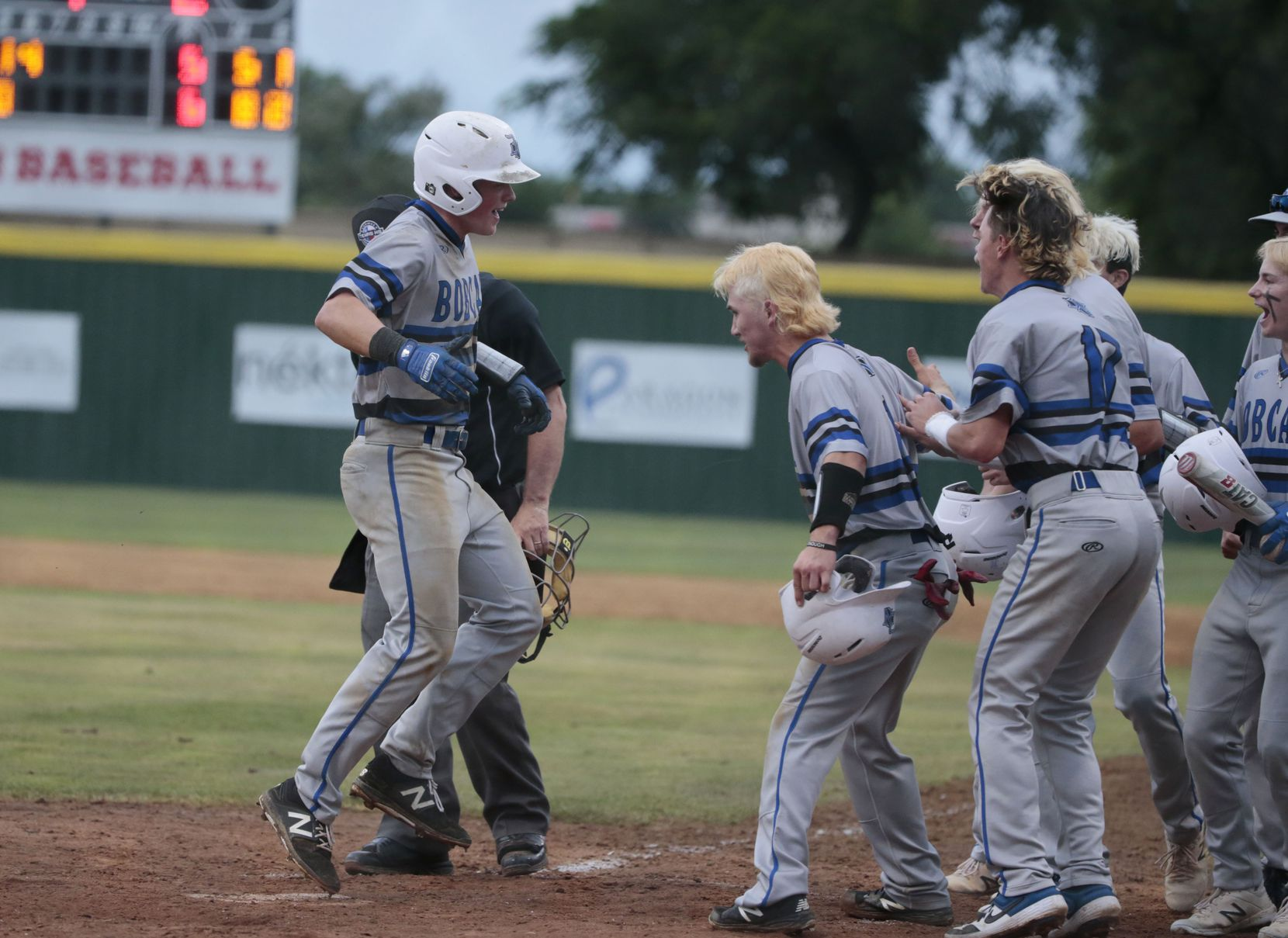 Byron Nelson's Hudson White is greeted buy teammates after his three-run home run to tie the game against Flower Mound Marcus in the 6th inning, during game 2 of the Class 6A bi-district playoff boys baseball playoffs on May 3, 2019. (Michael Ainsworth/Special Contributor)