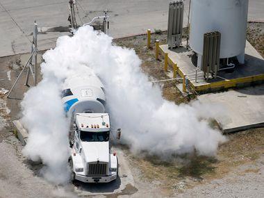 Liquid nitrogen is inserted into a Martin Marietta concrete truck to cool the load to the proper temperature at the concrete plant in McKinney.