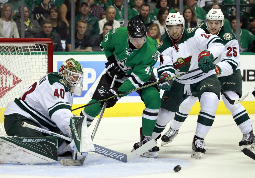 The puck rebounds away after Dallas Stars right wing Valeri Nichushkin (43) attempted a shot on Minnesota Wild goalie Devan Dubnyk (40) and defenseman Matt Dumba (24) in the first period during Game 5 of the Western Conference Quarterfinals at the American Airlines Center in Dallas, Friday, April 22, 2016. (Tom Fox/The Dallas Morning News)