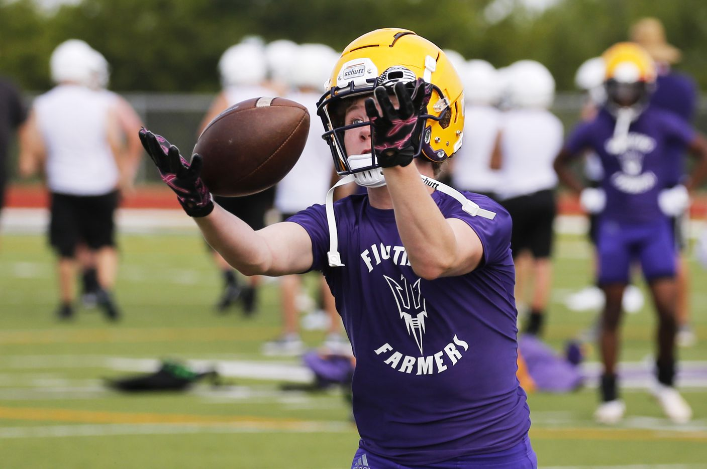 Farmersville's Gavin Parks makes a catch in a drill during the first day of high school football practice for 4A's Farmersville High School in Farmersville, Texas on Monday, August 3, 2020. (Vernon Bryant/The Dallas Morning News)