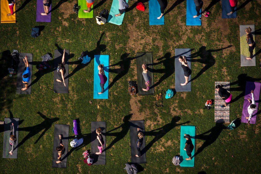 Dallas Yoga Center hosts a yoga class at Klyde Warren Park on Saturday, March 25, 2017, in Dallas, TX.