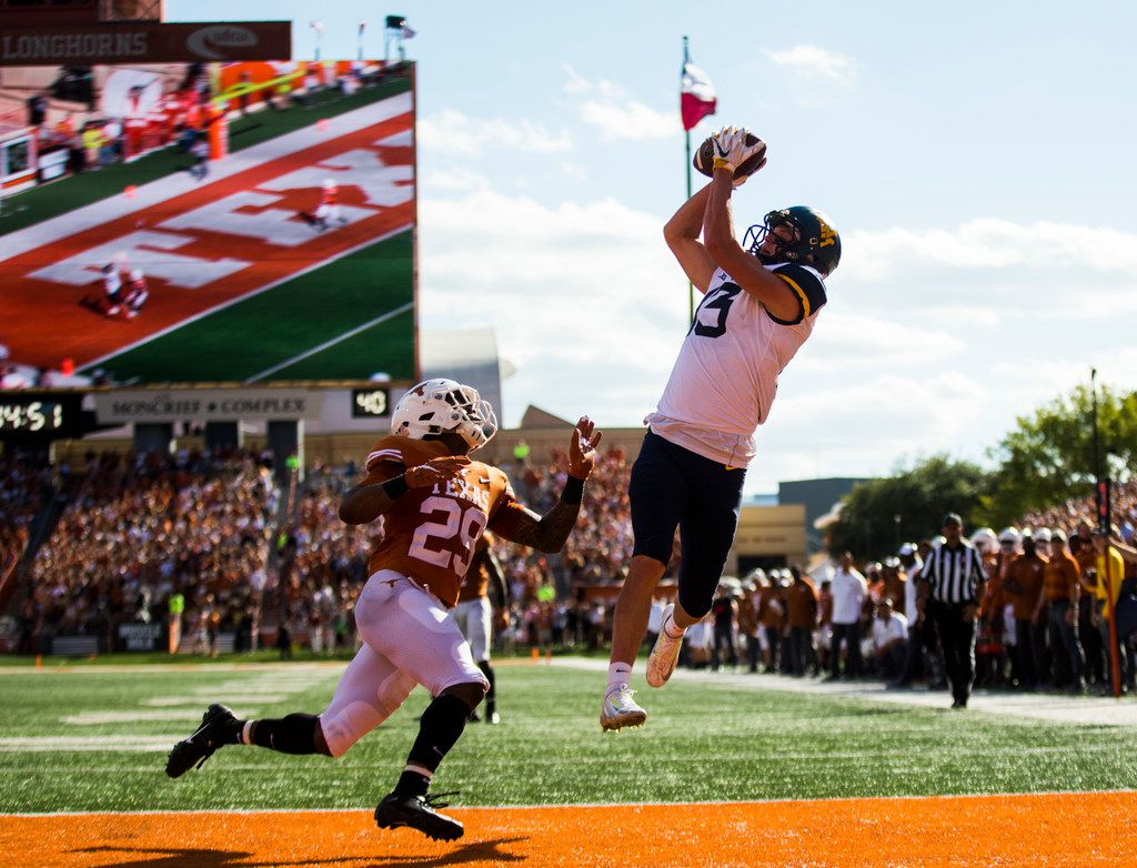 West Virginia Mountaineers wide receiver David Sills V (13) catches a pass in the end zone for a touchdown during the second quarter of a college football game between the University of Texas and West Virginia on Saturday, November 3, 2018 at Darrell Royal Memorial Stadium in Austin, Texas. Texas Longhorns defensive back Josh Thompson (29) defended. (Ashley Landis/The Dallas Morning News)