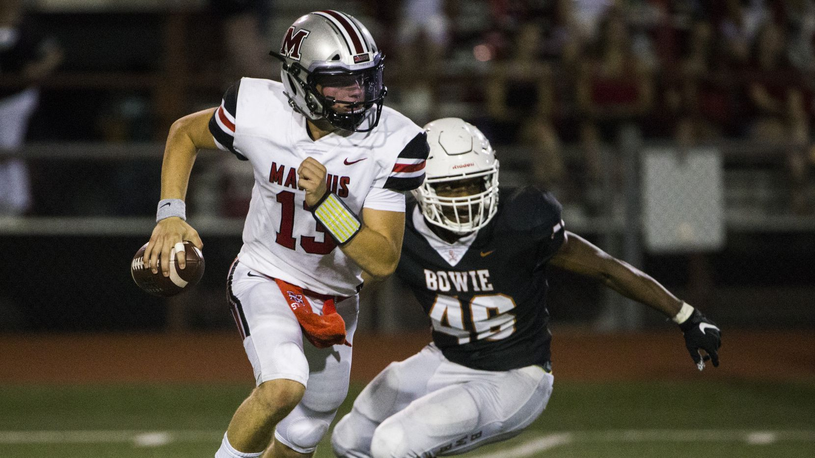 Flower Mound Marcus quarterback Garrett Nussmeier (13) is threatened by Arlington Bowie defensive lineman Anthony Starter (46) during the fourth quarter of a high school football game between Flower Mound Marcus and Arlington Bowie on Thursday, August 29, 2019 at Wilemon Field in Arlington.