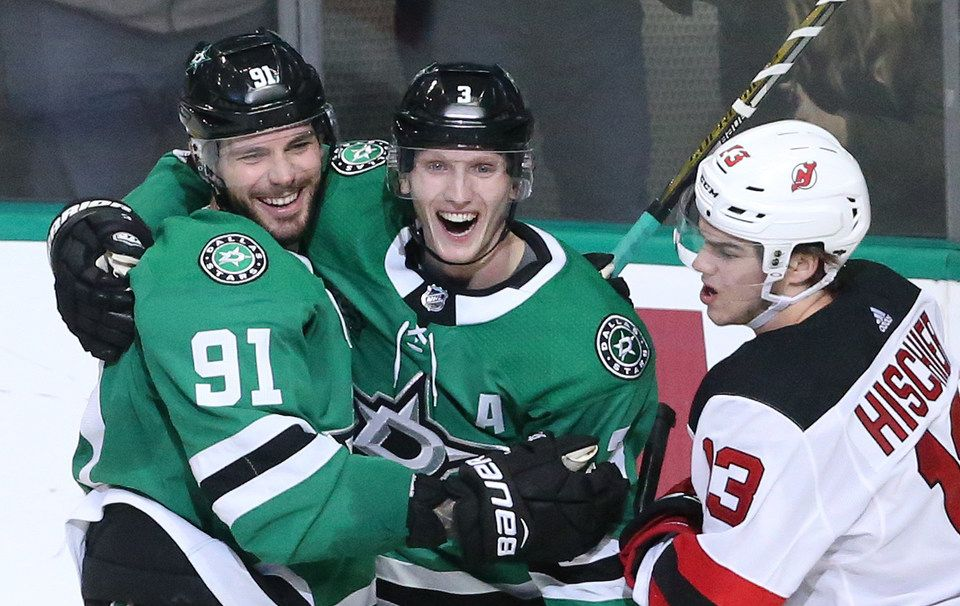Dallas Stars Tyler Seguin (91) and John Klingberg (3) celebrate Seguin's goal in the second period as New Jersey Devils Nico Hischier (13) skates past during the New Jersey Devils vs. the Dallas Stars NHL hockey game at the American Airlines Center in Dallas on Thursday, January 4, 2018.