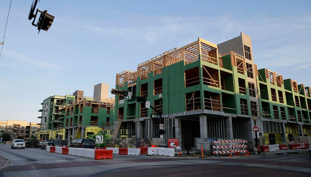Apartments under construction at the intersection of 14th street and Avenue K in Plano, Texas on Wednesday, July 25, 2018.  A new DART station is planned to be developed blocks away. (Vernon Bryant/The Dallas Morning News)