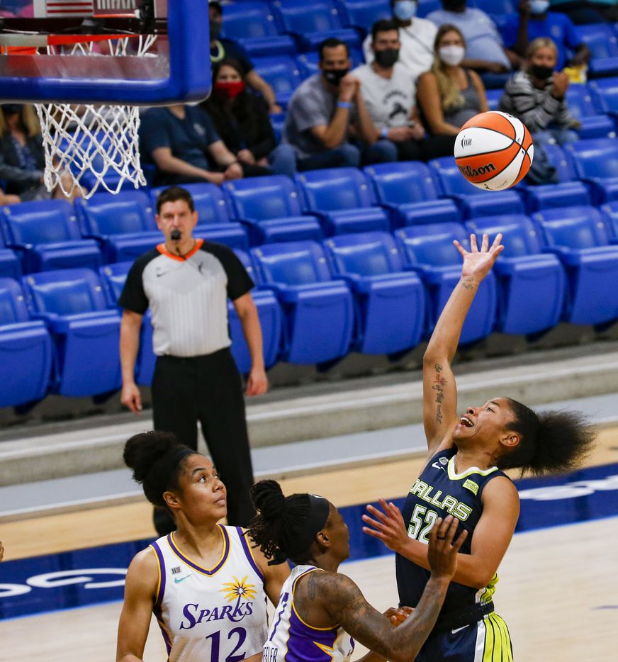 Dallas Wings guard Tyasha Harris (52) goes for a shot in the second quarter against the Los Angeles Sparks at College Park Center on Tuesday, June 1, 2021, in Arlington. (Juan Figueroa/The Dallas Morning News)