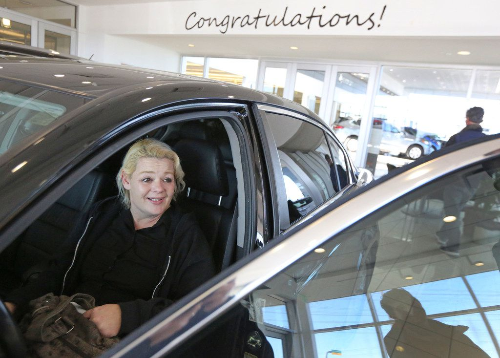 Christal Scott reacts to receiving a 2012 Honda Accord at Ewing Buick-GMC dealership in Plano on Jan. 16, 2018. The Watchdog wrote about  Christal, a single mom waitress, who lost her car to another auto dealership's repossession and had to go to court for resolution.