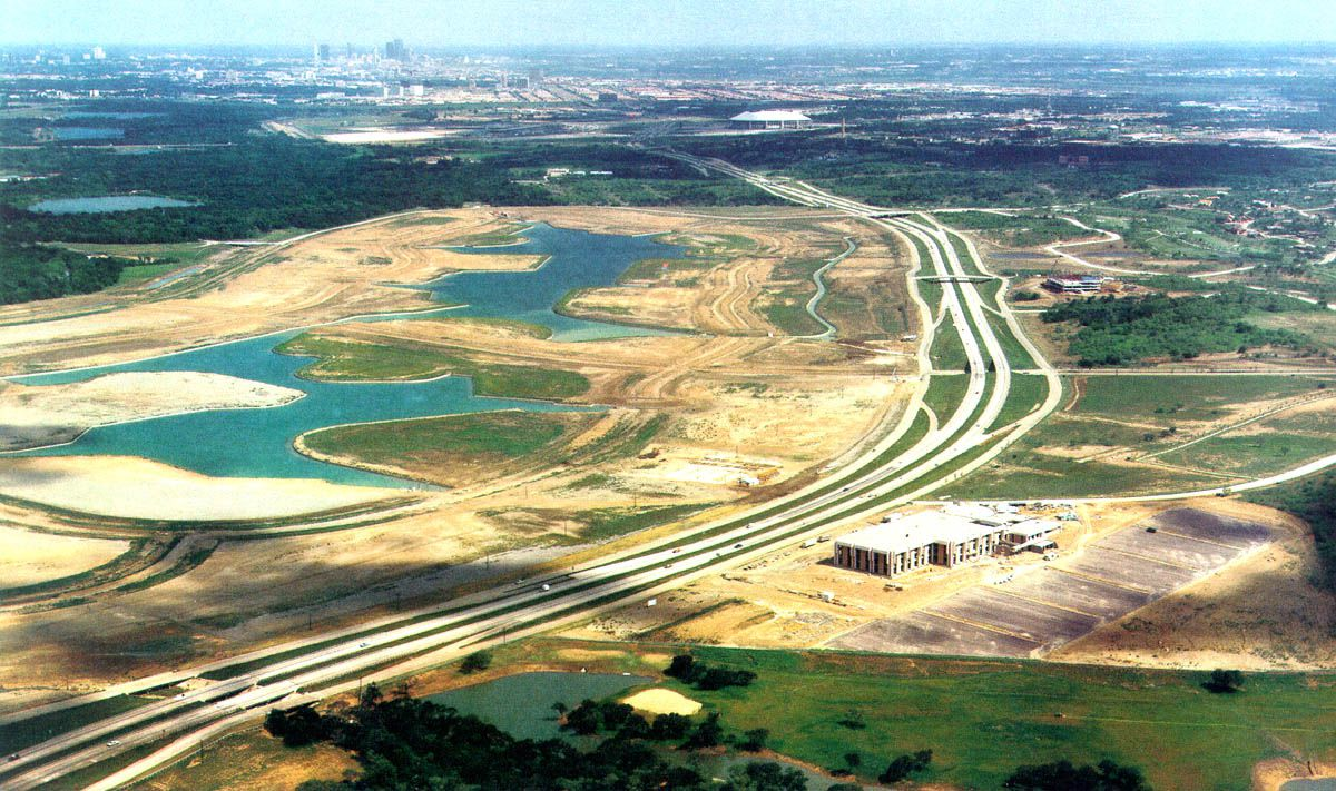 The building that housed Allstate's regional office is shown under construction in the lower right of the photo. The rest of Las Colinas was just starting.
